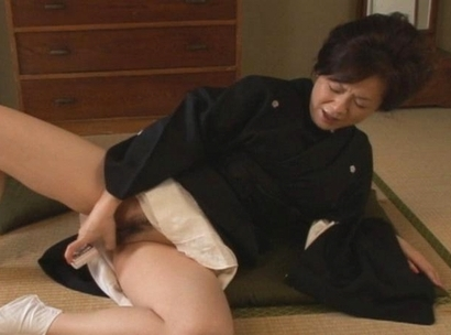 Hot Asian MILF is masturbating